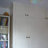 Floor to ceiling fitted cupboards